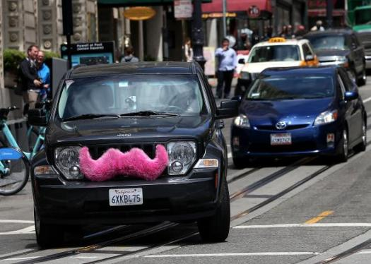 450502210-lyft-car-drives-along-powell-street-on-june-12-2014-in.jpg.CROP.promo-mediumlarge